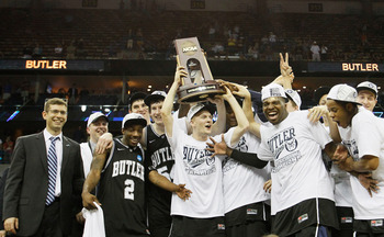 NEW ORLEANS, LA - MARCH 26:  The Butler Bulldogs celebrate with the trophy after defeating the Florida Gators 74 to 71 in overtime during the Southeast regional final of the 2011 NCAA men's basketball tournament at New Orleans Arena on March 26, 2011 in N