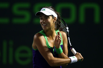 KEY BISCAYNE, FL - MARCH 25:  Ana Ivanovic of Serbia follows through on a return against Kimiko Date-Krumm of Japan during the Sony Ericsson Open at Crandon Park Tennis Center on March 25, 2011 in Key Biscayne, Florida.  (Photo by Clive Brunskill/Getty Im