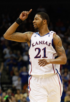 TULSA, OK - MARCH 20:  Markieff Morris #21 of the Kansas Jayhawks celebrates after a play against the Illinois Fighting Illini during the third round of the 2011 NCAA men's basketball tournament at BOK Center on March 20, 2011 in Tulsa, Oklahoma.  (Photo