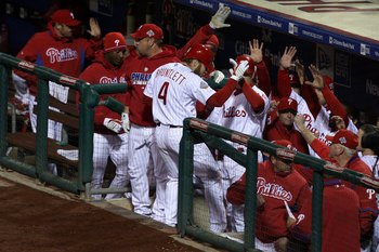 PHILADELPHIA - OCTOBER 29:  Eric Bruntlett #4 of the Philadelphia Phillies celebrates with teammates after he scored on a RBI single by Pedro Feliz in the bottom of the seventh inning against the Tampa Bay Rays during the continuation of game five of the