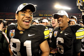 MIAMI GARDENS, FL - JANUARY 05:  (L-R) Tony Moeaki #81 and Keenan Davis #6 of the Iowa Hawkeyes celebrate after Iowa won 24-14 against the Georgia Tech Yellow Jackets during the FedEx Orange Bowl at Land Shark Stadium on January 5, 2010 in Miami Gardens,
