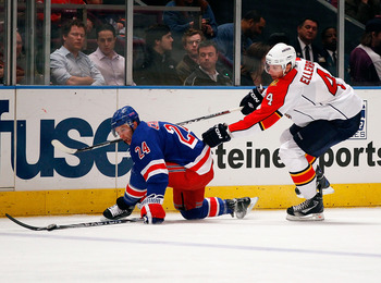 NEW YORK - MARCH 22: Ryan Callahan #24 of the New York Rangers and Keaton Ellerby #4 of the Florida Panthers fall to the ice pursuing the puck on March 22, 2011 at Madison Square Garden in New York City, New York. Rangers defeated the Panthers 1-0. (Photo