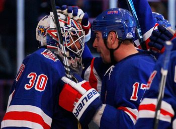NEW YORK - MARCH 22:  Brandon Dubinsky #17 of the New York Rangers celebrates with goaltender Henrik Lundqvist #30 after defeating the Florida Panthers on March 22, 2011 at Madison Square Garden in New York City, New York. Rangers defeated the Panthers 1-