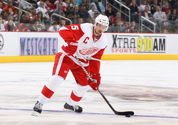 GLENDALE, AZ - MARCH 05:  Nicklas Lidstrom #5 of the Detroit Red Wings skates with the puck during the NHL game against the Phoenix Coyotes at Jobing.com Arena on March 5, 2011 in Glendale, Arizona. The Coyotes defeated the Red Wings 5-4 in an overtime sh