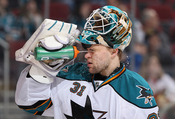 GLENDALE, AZ - MARCH 26:  Goaltender Antti Niemi #31 of the San Jose Sharks sprays himself with water before the start of the second period of the NHL game against the Phoenix Coyotes at Jobing.com Arena on March 26, 2011 in Glendale, Arizona.  (Photo by