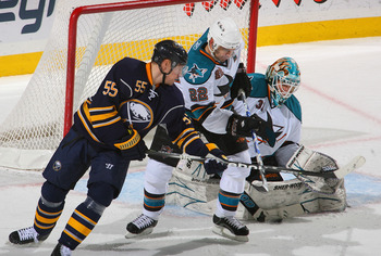 BUFFALO, NY - DECEMBER 09: Antti Niemi #31 of the San Jose Sharks makes a save and Dan Boyle #22 of the Sharks defends against Jochen Hecht #55 of the Buffalo Sabres at HSBC Arena on December 9, 2010 in Buffalo, New York.  (Photo by Rick Stewart/Getty Ima