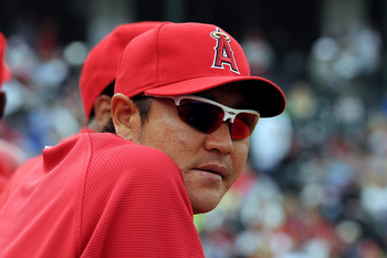 TEMPE, AZ - FEBRUARY 26:  Hisanori Takahashi #21 of the Los Angeles Angels of Anaheim watches from the bench during a game against the Los Angeles Dodgers at Tempe Diablo Stadium on February 26, 2011 in Tempe, Arizona.  (Photo by Norm Hall/Getty Images)