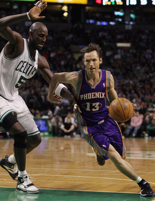 BOSTON, MA - MARCH 02:  Steve Nash #13 of the Phoenix Suns drives around Kevin Garnett #5 of the Boston Celtics on March 2, 2011 at the TD Garden in Boston, Massachusetts.  The Celtics defeated the Suns 115-103. NOTE TO USER: User expressly acknowledges a