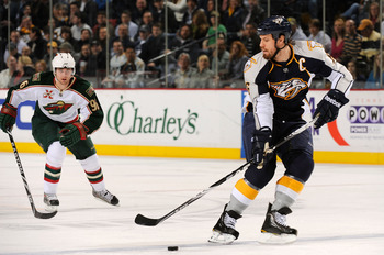 NASHVILLE, TN - MARCH 10:  Shea Weber #6 of the Nashville Predators carries the puck past Pierre-Marc Bouchard #96 of the Minnesota Wild on March 10, 2011 at the Bridgestone Arena in Nashville, Tennessee.  (Photo by Frederick Breedon/Getty Images)