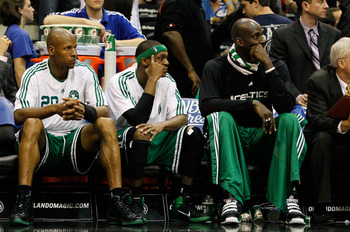 ORLANDO, FL - MAY 26:  (L-R) Ray Allen #20, Rajon Rondo #9 and Keivn Garnett #5 of the Boston Celtics look on dejected from the bench in the final minutes of their 113-92 loss to the Orlando Magic in Game Five of the Eastern Conference Finals during the 2