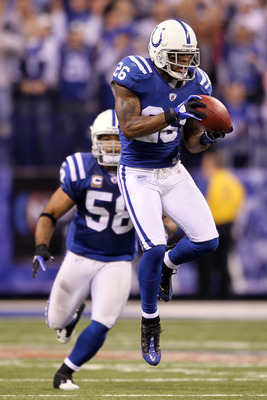 INDIANAPOLIS - JANUARY 24:  Kelvin Hayden #26 of the Indianapolis Colts intercepts a pass thrown by quarterback Mark Sanchez #6 of the New York Jets in the fourth quarter during the AFC Championship Game at Lucas Oil Stadium on January 24, 2010 in Indiana