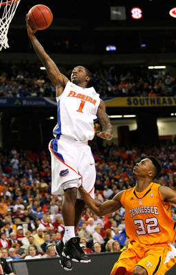 ATLANTA, GA - MARCH 11:  Kenny Boynton #1 of the Florida Gators shoots over Scotty Hopson #32 of the Tennessee Volunteers during the quarterfinals of the SEC Men's Basketball Tournament at Georgia Dome on March 11, 2011 in Atlanta, Georgia.  (Photo by Kev