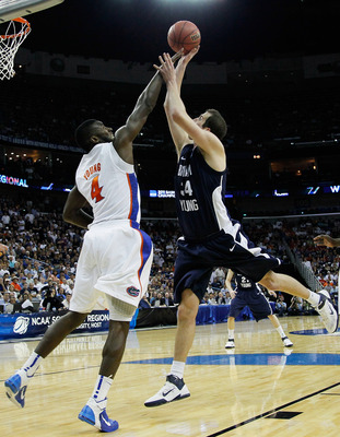 NEW ORLEANS, LA - MARCH 24:  Noah Hartsock #34 of the Brigham Young Cougars shoots against Patric Young #4 of the Florida Gators during the Southeast regional of the 2011 NCAA men's basketball tournament at New Orleans Arena on March 24, 2011 in New Orlea