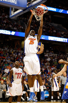 TAMPA, FL - MARCH 17:  Will Yeguete #15 of the Florida Gators dunks against the UC Santa Barbara Gauchos during the second round of the 2011 NCAA men's basketball tournament at St. Pete Times Forum on March 17, 2011 in Tampa, Florida. Florida won 79-51. (