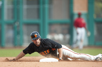 SCOTTSDALE, AZ - FEBRUARY 25: Andres Torres #56  of the San Francisco Giants attempts to steal second base during a spring training game against the Arizona Diamondbacks at Scottsdale Stadium on February 25, 2011 in Scottsdale, Arizona. (Photo by Rob Trin