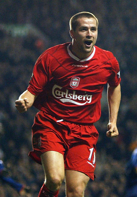 LIVERPOOL, ENGLAND - MARCH 17:  Michael Owen of Liverpool celebrates scoring his second goal during the FA Barclaycard Premiership match between Liverpool and Portsmouth at Anfield on March 17, 2004 in Liverpool, England.  (Photo by Bryn Lennon/Getty Imag