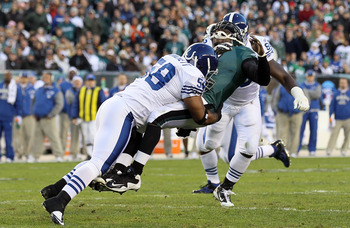 PHILADELPHIA - NOVEMBER 07:  Michael Vick #7 of the Philadelphia Eagles is hit hard by Gary Brackett #58 of the Indianapolis Colts after throwing a pass on November 7, 2010 at Lincoln Financial Field in Philadelphia, Pennsylvania.  (Photo by Jim McIsaac/G