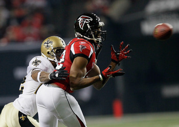 ATLANTA, GA - DECEMBER 27:  Michael Jenkins #12 of the Atlanta Falcons reaches for a pass in front of Tracy Porter #22 of the New Orleans Saints during their game at the Georgia Dome on December 27, 2010 in Atlanta, Georgia.  (Photo by Kevin C. Cox/Getty