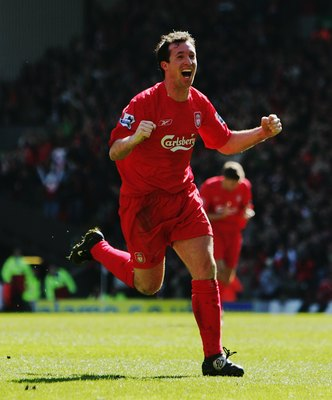 LIVERPOOL, UNITED KINGDOM - APRIL 09:  Robbie Fowler of Liverpool celebrates scoring the opening goal during the Barclays Premiership match between Liverpool and Bolton Wanderers at Anfield on April 9, 2006 in Liverpool, England.  (Photo by Laurence Griff