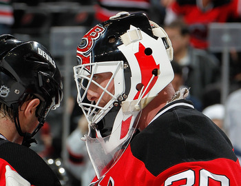 NEWARK, NJ - JANUARY 20:  Goalie Martin Brodeur #30 of the New Jersey Devils is congratulated on his shutout win after an NHL hockey game against the Pittsburgh Penguins at the Prudential Center on January 20, 2011 in Newark, New Jersey.  (Photo by Paul B