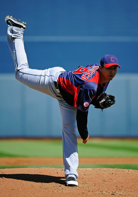 PEORIA, AZ - MARCH 13:  Pitcher Carlos Carrasco #59 of the Cleveland Indians throws a pitch against the San Diego Padres during the spring training baseball game at Peoria Stadium on March 13, 2011 in Peoria, Arizona.  (Photo by Kevork Djansezian/Getty Im