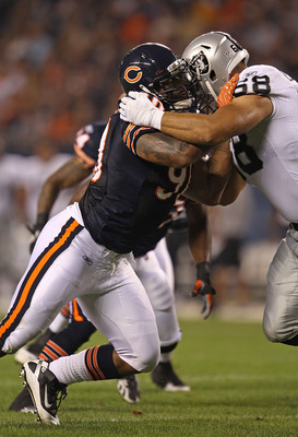 CHICAGO - AUGUST 21: Julius Peppers #90 of the Chicago Bears rushes against Jared Veldheer #68 of the Oakland Raiders during a preseason game at Soldier Field on August 21, 2010 in Chicago, Illinois. The Radiers defeated the Bears 32-17. (Photo by Jonatha