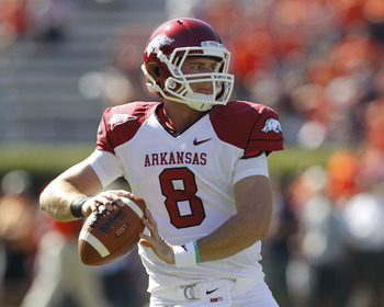 AUBURN, AL - OCTOBER 16:  Quarterback Tyler Wilson #8 of the Arkansas Razorbacks drops back and looks downfield before the game against the Auburn Tigers at Jordan-Hare Stadium on October 16, 2010 in Auburn, Alabama.  The Tigers beat the Razorbacks 65-43.