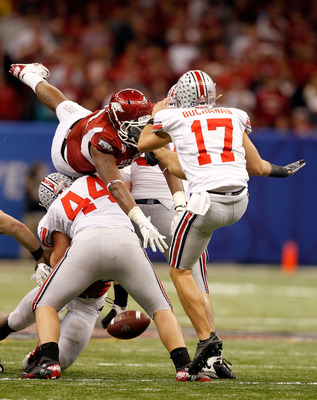 NEW ORLEANS, LA - JANUARY 04:  Chris Gragg #80 of the Arkansas Razorbacks blocks a punt by Ben Buchanan #17 of the Ohio State Buckeyes in the fourth quarter during the Allstate Sugar Bowl at the Louisiana Superdome on January 4, 2011 in New Orleans, Louis