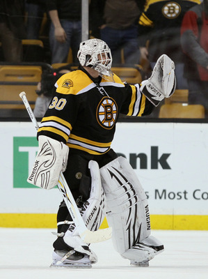 BOSTON, MA - MARCH 24:  Tim Thomas #30 of the Boston Bruins celebrates his shut out after the game against the Montreal Canadiens  on March 24, 2011 at the TD Garden in Boston, Massachusetts.  The Boston Bruins defeated the Montreal Canadiens 7-0.  (Photo