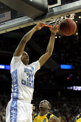 NEWARK, NJ - MARCH 25:  John Henson #31 of the North Carolina Tar Heels dunks against the Marquette Golden Eagles during the east regional semifinal of the 2011 NCAA Men's Basketball Tournament at the Prudential Center on March 25, 2011 in Newark, New Jer