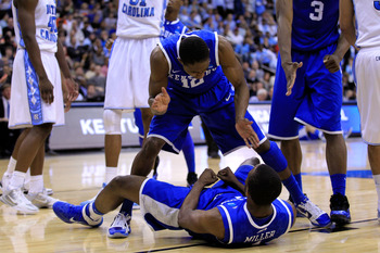 NEWARK, NJ - MARCH 27:  Brandon Knight #12 of the Kentucky Wildcats stands over Darius Miller #1 after a point against the North Carolina Tar Heels during the second half of the east regional final of the 2011 NCAA men's basketball tournament at Prudentia