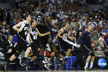 NEW ORLEANS, LA - MARCH 26:  The Butler Bulldogs celebrate after defeating the Florida Gators 74 to 71 in overtime during the Southeast regional final of the 2011 NCAA men's basketball tournament at New Orleans Arena on March 26, 2011 in New Orleans, Loui