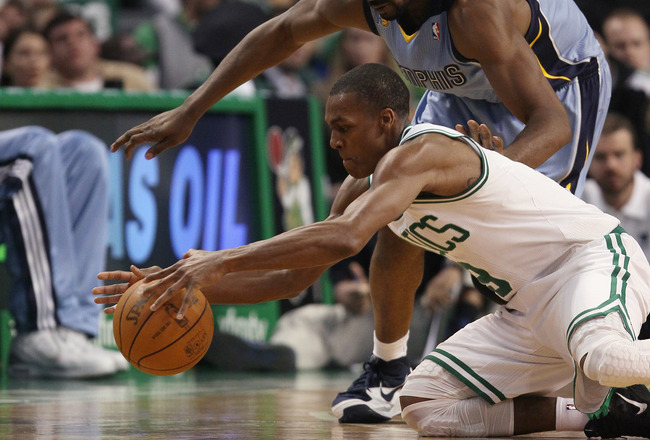 BOSTON, MA - MARCH 23:  Rajon Rondo #9 of the Boston Celtics and Leon Powe #7 of the Memphis Grizzlies fight for the ball on March 23, 2011 at the TD Garden in Boston, Massachusetts.  The Memphis Grizzlies defeated the Boston Celtics 90-87. NOTE TO USER: