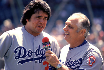 CHICAGO, IL - JUNE 7: Pitcher Fernando Valenzuela #34 of the Los Angeles Dodgers is interviewed by his manager Tommy Lasorda #2 before the game against the Chicago Cubs on June 7, 1981 at Wrigley Field in Chicago, Illinois. (Photo by Jonathan Daniel/Getty