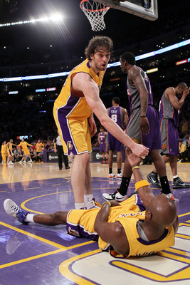 LOS ANGELES, CA - MAY 27:  Pau Gasol #16 of the Los Angeles Lakers helps teammate Lamar Odom #7 up after a play against the Phoenix Suns in the third quarter of Game Five of the Western Conference Finals during the 2010 NBA Playoffs at Staples Center on M