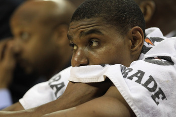 CHARLOTTE, NC - FEBRUARY 14:  Andrew Bynum #17 of the Los Angeles Lakers reacts as he sits on the bench during their game against the Charlotte Bobcats at Time Warner Cable Arena on February 14, 2011 in Charlotte, North Carolina. NOTE TO USER: User expres