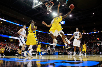 CLEVELAND, OH - MARCH 18: Darius Johnson-Odom #1 of the Marquette Golden Eagles drives to the basket against Jeff Robinson #21 of the Xavier Musketeers during the second round of the 2011 NCAA men's basketball tournament at Quicken Loans Arena on March 18