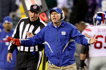 PHILADELPHIA - NOVEMBER 21:  Head coach Tom Coughlin of the New York Giants reacts after a fumble by Eli Manning #10 late in the fourth quarteragainst the Philadelphia Eagles at Lincoln Financial Field on November 21, 2010 in Philadelphia, Pennsylvania. (