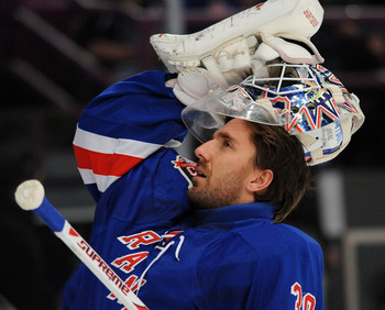 NEW YORK, NY - MARCH 24: Henrik Lundqvist #30 of the New York Rangers looks at the crowd as he puts his mask on prior to the game against the Ottawa Senators at Madison Square Garden on March 24, 2011 in New York City. (Photo by Christopher Pasatieri/Gett