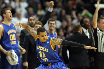 DENVER, CO - MARCH 17:  Terrance Hill #11 of the Morehead State Eagles reacts after hitting a three pointer in the second half against the Louisville Cardinals during the second round of the 2011 NCAA men's basketball tournament at Pepsi Center on March 1