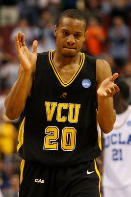 PHILADELPHIA - MARCH 19:  Bradford Burgess #20 of the VCU Rams cheers during the game against the UCLA Bruins during the first round of the NCAA Division I Men's Basketball Tournament at the Wachovia Center on March 19, 2009 in Philadelphia, Pennsylvania.