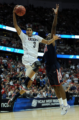 ANAHEIM, CA - MARCH 26:  Jeremy Lamb #3 of the Connecticut Huskies dunks the ball against Solomon Hill #44 of the Arizona Wildcats during the west regional final of the 2011 NCAA men's basketball tournament at the Honda Center on March 26, 2011 in Anaheim