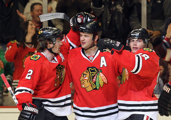 CHICAGO, IL - MARCH 23: Brent Seabrook #7 of the Chicago Blackhawks scores at 14:41 of the second period against the Florida Panthers and is joined by Duncan Keith #2 (L) and Patrick Kane #88 (R) at the United Center on March 23, 2011 in Chicago, Illinois