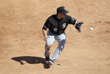 TUCSON, AZ - MARCH 07:  Infielder Brent Morel #22 of the Chicago White Sox fields a ground ball out against the Arizona Diamondbacks during the spring training game at Kino Veterans Memorial Stadium on March 7, 2011 in Tucson, Arizona. The charity game is
