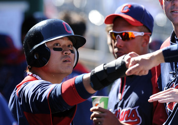 GOODYEAR, AZ - MARCH 11:  Shin-Soo Choo #17 of the Cleveland Indians gets congratulated by a teammate after scoring a run against the Seattle Mariners at Goodyear Ballpark on March 11, 2011 in Goodyear, Arizona.  (Photo by Norm Hall/Getty Images)
