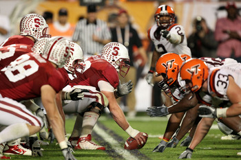 MIAMI, FL - JANUARY 03:  Center Chase Beeler #72 of the Stanford Cardinal readies the ball for the snap at the line of scrimmage against the Virginia Tech Hokies defense during the 2011 Discover Orange Bowl at Sun Life Stadium on January 3, 2011 in Miami,