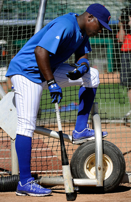 MESA, AZ - MARCH 09:  Alfonso Soriano #12 of the Chicago Cubs attends batting practice before the spring training baseball game against the Kansas City Royals at HoHoKam Stadium on March 9, 2011 in Mesa, Arizona.  (Photo by Kevork Djansezian/Getty Images)