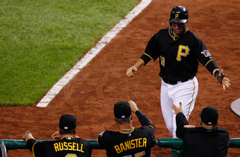 PITTSBURGH - SEPTEMBER 21:  Neil Walker #18 of the Pittsburgh Pirates is congratulated by manager John Russell #7 and pitching coach Jeff Banister #55 after scoring against the St. Louis Cardinals during the game on September 21, 2010 at PNC Park in Pitts