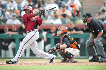 SCOTTSDALE, AZ - FEBRUARY 25: Justin Upton #10 of the Arizona Diamondbacks bats during a spring training game San Francisco Giant at Scottsdale Stadium on February 25, 2011 in Scottsdale, Arizona. (Photo by Rob Tringali/Getty Images)