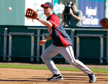 FORT MYERS, FL - FEBRUARY 23:  Infielder Justin Morneau #33 of the Minnesota Twins fields some balls during a spring training workout session at Hammond Stadium on February 23, 2011 in Fort Myers, Florida.  (Photo by J. Meric/Getty Images)